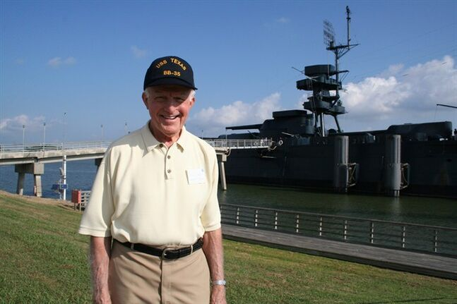This image provided by Battleship Texas Archives shows former crewman Emil Saul next to the USS Texas in 2005. In honor of the 70th anniversary of the June 6, 1944, D-Day invasion, the flag that was aloft will go on public display Friday for the first time since World War II in an exhibit at the Houston Museum of Natural Science thanks to a Saul, who gifted the flag. (AP Photo/Battleship Texas Archives)