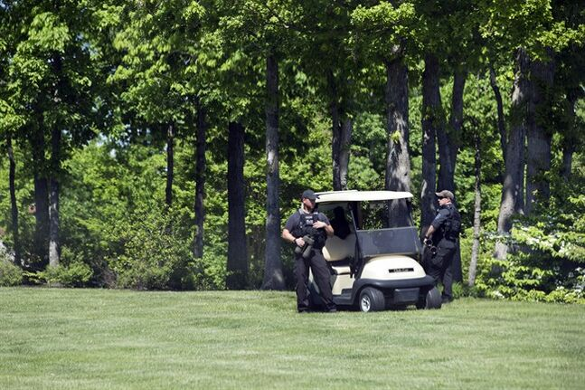 Secret Service countersniper members stand guard as the motorcade carrying President Barack Obama arrives at the Robert Trent Jones Golf Course where the president is expected to play golf in Gainesville, Va., on Saturday, May 17, 2014. (AP Photo/Jacquelyn Martin)