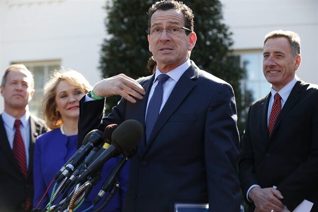 Connecticut Gov. Dannel Malloy, center, speaks to reporters outside the White House in Washington, Monday, Feb. 24, 2014, following a meeting between President Barack Obama and members of the National Governors Association (NGA). From left are, Maryland Gov. Martin O'Malley, NGA Chair, Oklahoma Gov. Mary Fallin, Malloy, and Vermont Gov. Peter Shumlin. (AP Photo/Charles Dharapak)