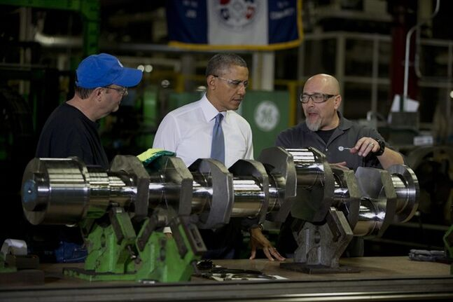 President Barack Obama looks at a crank shaft as he tours General Electric�??s Waukesha Gas Engines facility, Thursday, Jan. 30, 2014, in Waukesha, Wis. as part of a four-stop tour he is making to expand on themes from his State of the Union address. (AP Photo)