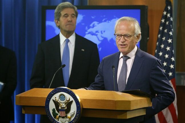 FILE - This July 29, 2013 file photo shows Secretary of State John Kerry listening as Martin Indyk speaks at the State Department in Washington. U.S. special Mideast envoy Martin Indyk is resigning after nearly a year of unsuccessful efforts to forge an Israeli-Palestinian peace deal, Obama administration officials said Friday. (AP Photo/Charles Dharapak, File)