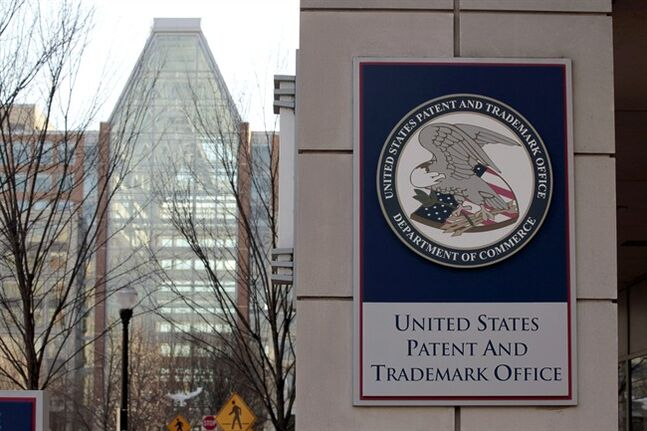 FILE - This Feb. 25, 2011 file photo shows Tthe U.S. Patent and Trademark Office in Alexandria, Va. The Supreme Court on Thursday tossed out an Australian company's patent for business software in a decision that clarifies standards for awarding patents, but not as much as some firms had hoped. In a case closely watched by the industry, justices ruled unanimously that the government should not have issued a patent to Alice Corp. in the 1990s because the company simply took an abstract idea that has been around for years and programmed it to run through a computer. (AP Photo/Alex Brandon)
