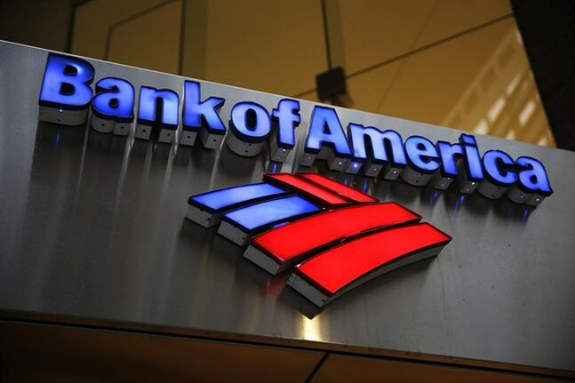 FILE - In this Jan. 14, 2014, file photo, a Bank of America sign is photographed in Philadelphia. A person familiar with the matter says Bank of America has agreed to pay between $16 billion and $17 billion to settle an investigation into its sale of mortgage-backed securities before the financial crisis. (AP Photo/Matt Rourke, File)
