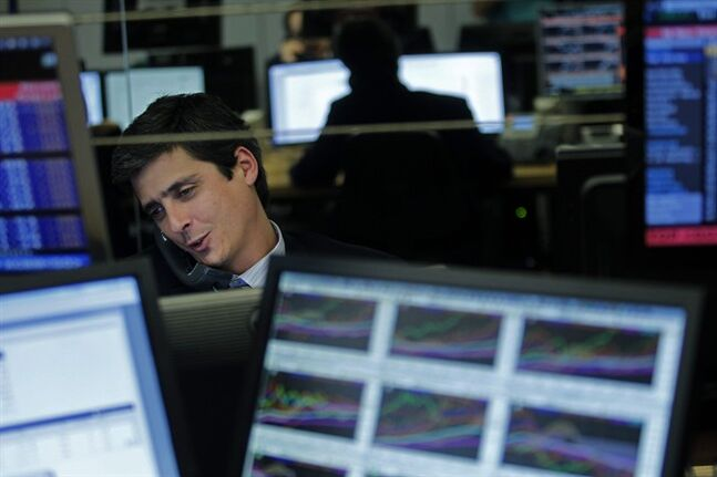 In this photo taken Feb. 18, 2014, a broker talks on the phone in the trading room of a Portuguese bank in Lisbon. The Portuguese are less than three months away from their big day _ May 17 _ when they expect to get their financial sovereignty back after three years of being told what to do by foreign bailout creditors. In return for the 78 billion-euro ($107 billion) rescue that has since 2011 prevented national bankruptcy, Portugal consented to an economic crash diet: deep cuts in pay and pensions and welfare rights, steep tax increases, and an end to long-standing labor entitlements. (AP Photo/Francisco Seco)
