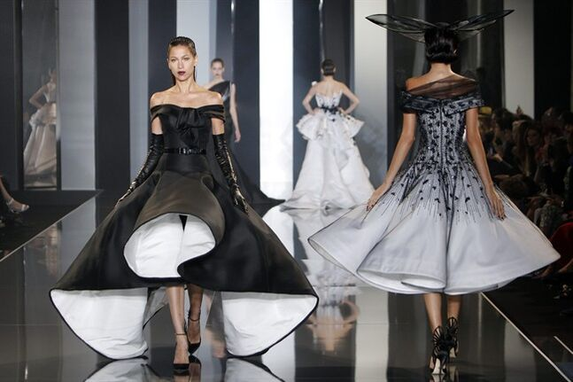 A model wears a creation for Ralph & Russo's fall-winter 2014-2015 Haute Couture fashion collection presented in Paris, France, Thursday, July 10, 2014. (AP Photo/Thibault Camus)