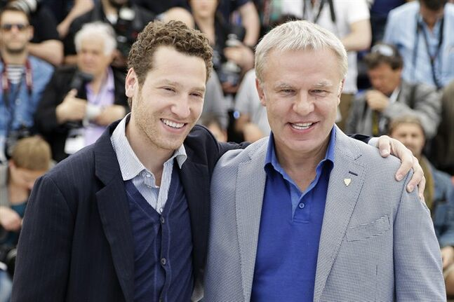 "FILE - In this Friday, May 16, 2014 file photo, director Gleb Polsky, left, and Slava Fetisov, the former captain of the Russian Red Army hockey team pose for photographers during a photo call for Red Army at the 67th international film festival, Cannes, southern France. Fetisov has had a storied hockey career - including two Stanley Cups with the Detroit Red Wings - but he was initially reluctant to see it documented with a movie, but director Gary Polsky eventually won him over, and the result is ""Red Army"" which is screening in the Cannes Film Festival. (AP Photo/Thibault Camus, File)"