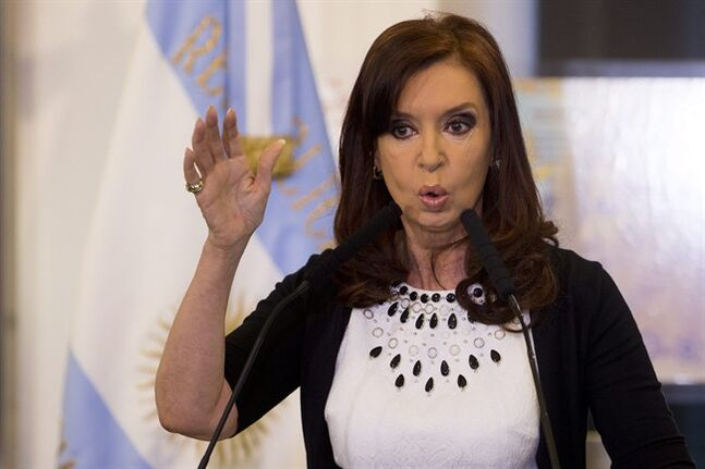 FILE - In this Feb. 12, 2014, file photo, Argentine President Cristina Fernandez gives a speech, aired on national TV, during an event at the Casa Rosada government palace in Buenos Aires, Argentina. President Fernandez said Monday June 16, 2014, that Argentina can't comply with U.S. court orders to pay $1.5 billion to winners of a decade-long legal battle over defaulted debt, the position her country was left in Monday when the U.S. Supreme Court refused to hear her government's final appeal. (AP Photo/Victor R. Caivano, File)