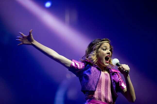 FILE - In this July 23, 2013 file photo, Disney Channel star Martina Stoessel, of Argentina, performs in concert as