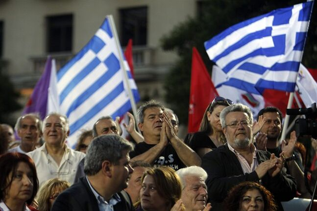 Greek left-wing opposition supporters listen to the speech of the leader Alexis Tsipras, a candidate for the European Union's parliament, in the northern Greek city of Thessaloniki on Wednesday, May 21, 2014. Around 400 million Europeans voters in 28 countries on Thursday begin choosing the next European Parliament and helping determine the EU's future leaders and course. Greece's rickety coalition government faces its second electoral test in local, regional and European parliamentary elections on Sunday which the left-wing opposition has billed as a referendum on the country's bailout. (AP Photo/Nikolas Giakoumidis)