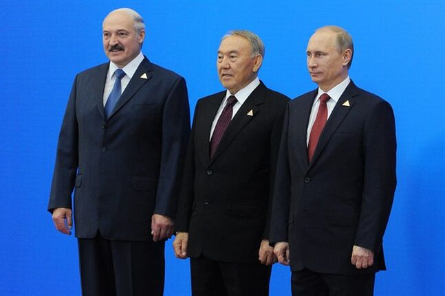 From left: Belarus President, Alexander Lukashenko, Kazakhstan's President, Nursultan Nazarbayev and Russian President, Vladimir Putin, pose for a photo after they agreed to create the Eurasian Economic Union, an alliance intended to further boost economic and trade ties between the ex-Soviet neighbors in Astana, Kazakhstan, Thursday, May 29, 2014. The new alliance is the development of the Customs Union including the same nations. In addition to free trade, it coordinates the members' financial systems and regulates industrial and agricultural policies along with their labor markets and transport systems. (AP Photo/RIA Novosti Kremlin, Mikhail Klimentyev, Presidential Press Service, Pool)