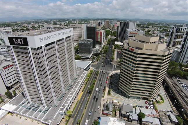 This July 16, 2014, phoro shows an aerial view of the financial district in San Juan, Puerto Rico. The territory's government has managed to buy some time to stave off an economic crisis, but it may only be for a moment. Creditors are closely watching whether the government tries to reach substantial agreements with banks this month on how to handle upcoming payments. (AP Photo/Ricardo Arduengo)