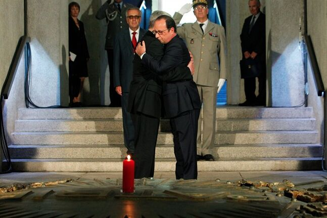 France's President Francois Hollande, right, hugs German President Joachim Gauck, left, as they pay respect in the crypt of the the National Monument of Hartmannswillerkop, in Wattwiller, eastern France, Sunday, August 3, 2014, to mark the 100th anniversary of the outbreak of World War I. On this day 100-years ago, in 1914, Germany declared war on France, at the beginning of the first global war, which centred on Europe and resulted in over nine million combatants being killed. (AP Photo/Thibault Camus, Pool)