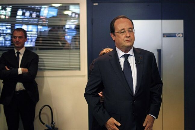 France's President Francois Hollande waits for an interview with BFM television journalist in Paris, Tuesday, May 6, 2014. Hollande celebrates Tuesday his second anniversary in charge. (AP Photo/Thibault Camus, Pool)