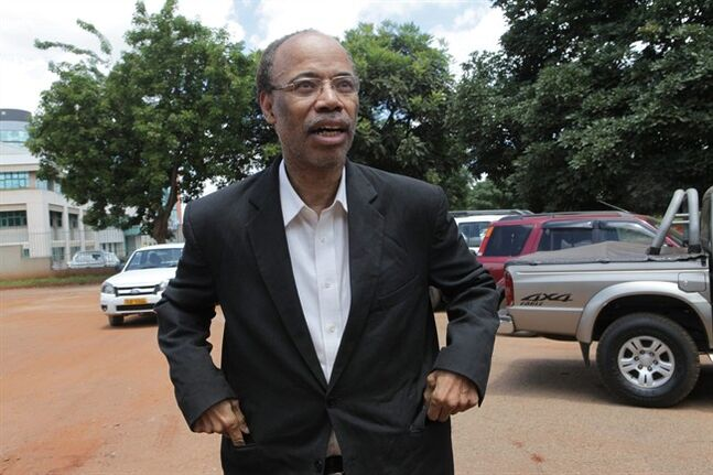 Former U S Congressman, Mel Reynolds, appears at the magistrates courts in Harare, Wednesday, Feb. 19, 2014. Reynolds was arrested in Zimbabwe for allegedly possessing pornographic material and violating immigration laws. (AP Photo/Tsvangirayi Mukwazhi)