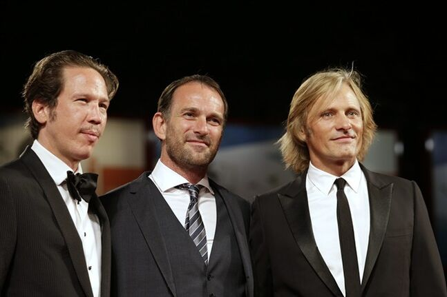 From right, actor Viggo Mortensen, director David Oelhoffen and actor Reda Kateb arrive on the red carpet for the screening of Loin des Hommes during the 71st edition of the Venice Film Festival in Venice, Italy, Sunday, Aug. 31, 2014. (AP Photo/David Azia)