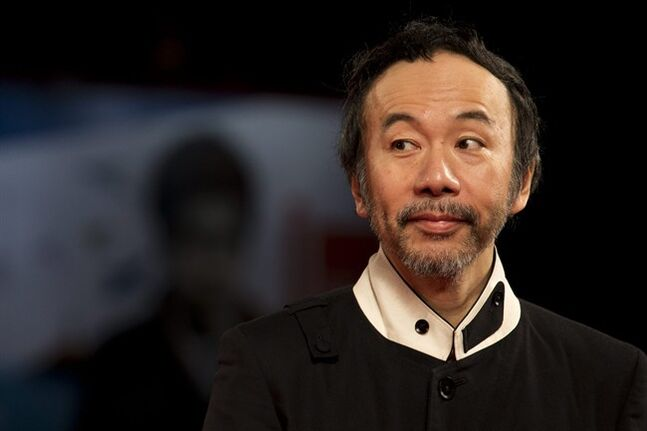 Director Shinya Tsukamoto poses for photographers as he arrives for the screening of Nobi (Fires on the Plain) at the 71st edition of the Venice Film Festival in Venice, Italy, Tuesday, Sept. 2, 2014. (AP Photo/David Azia)