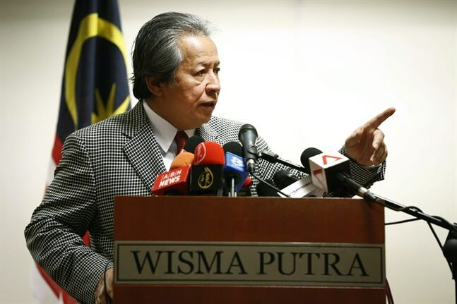 Malaysia's Foreign Minister Anifah Aman speaks during a press conference in Putrajaya, Malaysia, Tuesday, July 1, 2014. New Zealand officials on Tuesday identified a diplomat charged with sexual assault as Malaysian. The man, Muhammad Rizalman Bin Ismail, evaded the charges in New Zealand by claiming diplomatic immunity and returning home last month. He worked for the Malaysian High Commission in Wellington. He remained listed on the commission's website Tuesday as a staff assistant assigned to defense duties.(AP Photo/Vincent Thian)