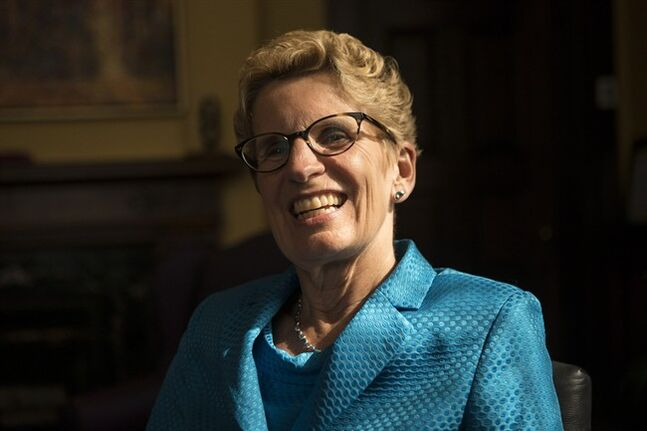 Ontario's newly-elected Premier Kathleen Wynne is photographed in her Queen's Park Office in Toronto on Wednesday June 18, 2014. THE CANADIAN PRESS/Chris Young