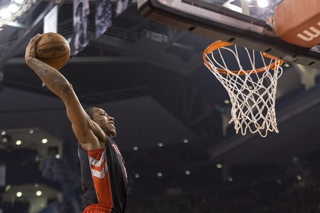 Toronto Raptors' DeMar DeRozan scores against Brooklyn Nets during first half NBA basketball action in Toronto on Saturday January 11 , 2014. THE CANADIAN PRESS/Chris Young
