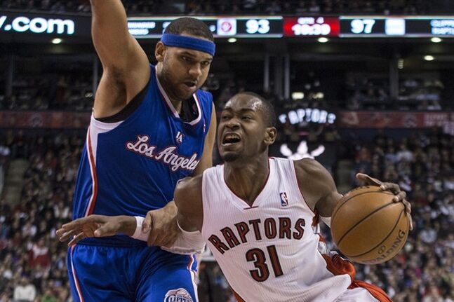 Toronto Raptors' Terrence Ross (right) drives past Los Angeles Clippers' Jared Dudley during second half NBA basketball action in Toronto on Saturday January 25 , 2014. THE CANADIAN PRESS/Chris Young