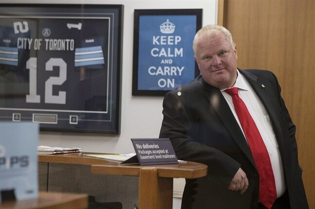 Toronto Mayor Rob Ford waits for an elevator before leaving his office at city hall to take part in a vote on Wednesday July 9, 2014. The mayor is facing allegations of inappropriate behaviour while in rehab. THE CANADIAN PRESS/Chris Young