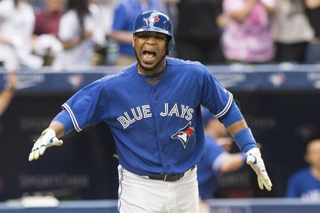 Toronto Blue Jays Edwin Encarnacion celebrates after hitting a walk-off three-run homer against the Milwaukee Brewers during ninth inning interleague baseball action in Toronto on Wednesday July 2 , 2014. THE CANADIAN PRESS/Chris Young