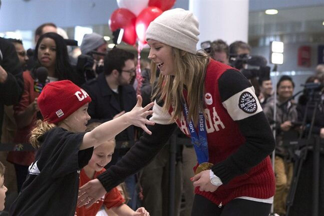 Canadian gold medallist in slopestyle skiing Dara Howell greets her seven-year-old second cousin Elise Hallett as she arrives at Toronto's Pearson Airport from the Sochi Winter Olympics on Monday, February 24, 2014. THE CANADIAN PRESS/Chris Young.