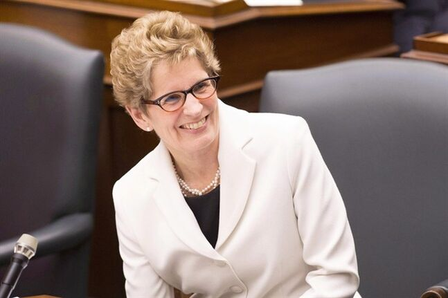 Ontario Premier Kathleen Wynne reacts as Lt.-Gov. David Onley delivers the throne speech at the Ontario Legislature in Toronto on Tuesday February 19, 2013. The Ontario legislature resumes Tuesday with the prospect of a spring election looming and the minority Liberal government reeling after another two byelection losses last week. THE CANADIAN PRESS/Chris Young
