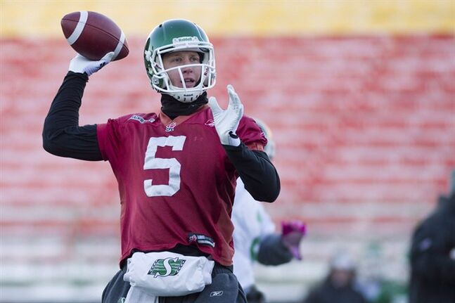 Quarterback Drew Willy throws a pass as the Saskatchewan Roughriders practice on Friday November 22, 2013 in Regina. The Winnipeg Blue Bombers acquired Willy from the Grey Cup-champion Roughriders for Canadian receiver Jade Etienne on Thursday.THE CANADIAN PRESS/Liam Richards