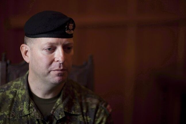 Capt. Darryl Watts speaks during an interview with The Canadian Press in Calgary on Dec 8, 2010. An appeal date has been set in April for Watts, a veteran Canadian Forces reservist convicted for his role in a deadly Afghanistan training accident.THE CANADIAN PRESS/Jonathan Hayward