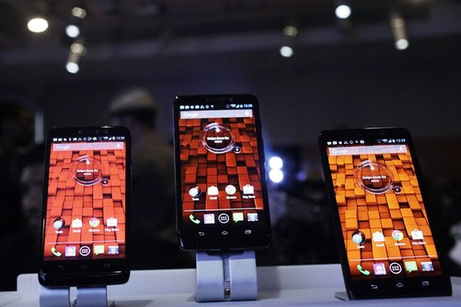Three smartphones from Verizon are displayed, July 23, 2013 in New York. THE CANADIAN PRESS/AP, Mark Lennihan