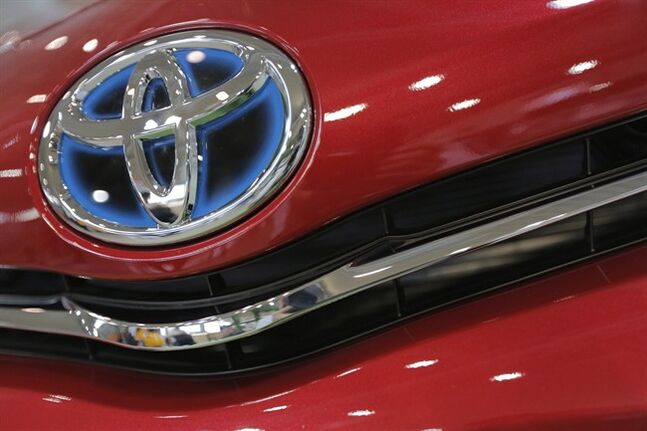 In this Aug. 2, 2013 photo, the emblem of a Toyota car shines in Tokyo. THE CANADIAN PRESS/AP, Itsuo Inouye
