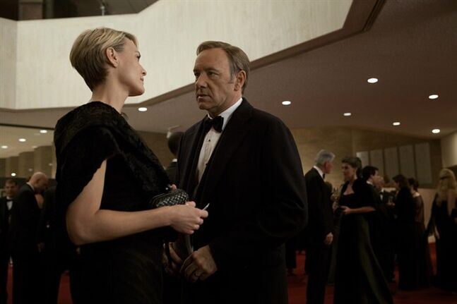 This image released by Netflix shows Robin Wright as Claire Underwood, left, and Kevin Spacey as U.S. Congressman Frank Underwood in