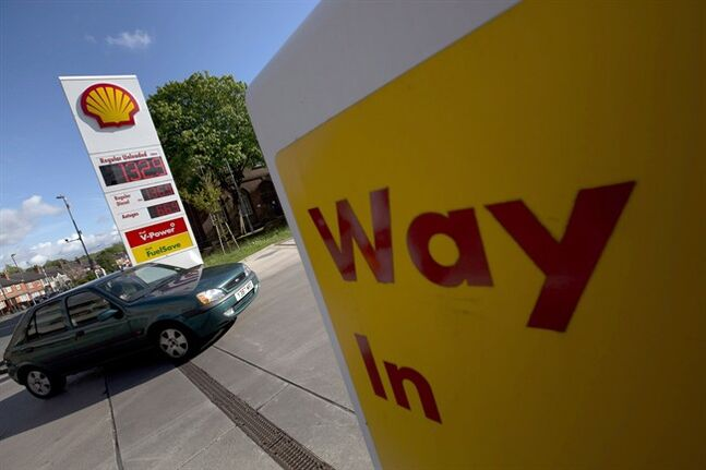A car enters a Shell petrol station in Manchester, England, May 15, 2013. THE CANADIAN PRESS/AP, Jon Super