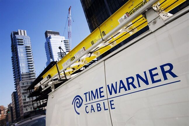 In this Feb. 2, 2009 photo, a Time Warner Cable truck is parked in New York. THE CANADIAN PRESS/AP, Mark Lennihan
