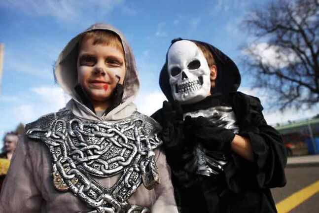 A couple of costumed kids out to collect treats in this photo, from 2011, would have encountered afternoon highs of 12 C, although temperatures dropped quickly in the evening, and it was raining by 10 p.m. That still counts as an above-average Halloween, by historic standards.