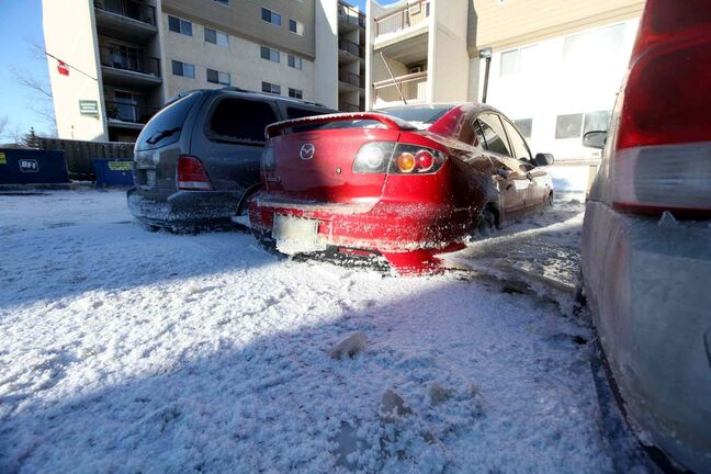 Vehicle stuck in ice after a major water main break on New Year's Eve Day on Jefferson.