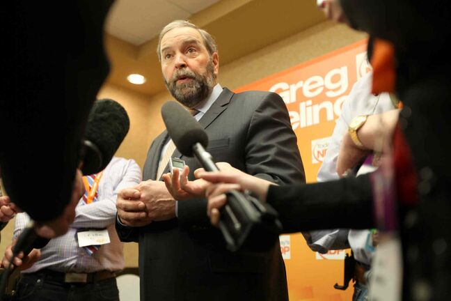 Federal NDP Leader Thomas Mulcair talks to the press after his speech at the Manitoba NDP convention at Canad Inns Polo Park Saturday.