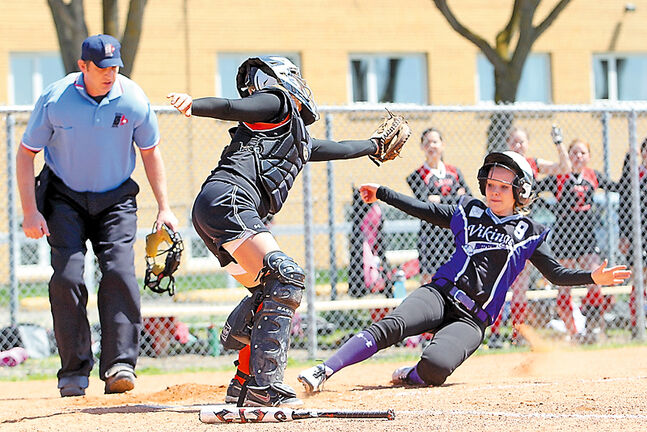 Megan Asham, shown sliding into home plate to score a run for Vincent Massey against the Major Pratt Trojans in 2013, has signed a letter of intent to play for Minnesota State University Moorhead.
