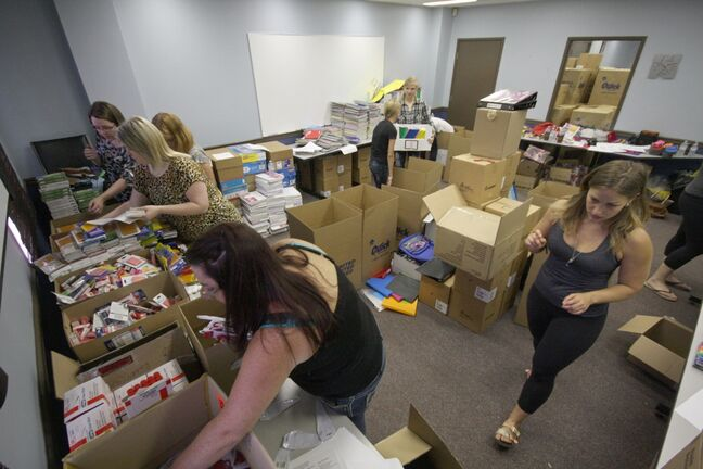 About a dozen United Way volunteers box up thousands of school items Friday as part of the Tools For School campaign. The notebooks, pencils, erasers, glue sticks and other items will be given out to more than 900 underprivileged kids throughout the Brandon School Division as the new school year begins Tuesday.
