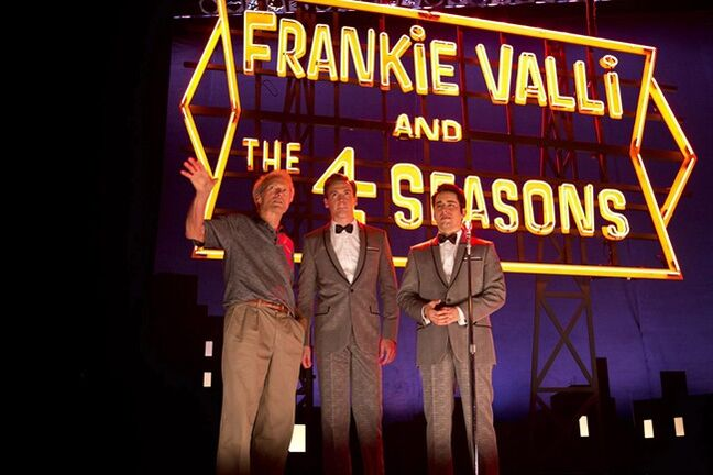 "This photo released by Warner Bros. shows director/producer, Clint Eastwood, from left, Erich Bergen and John Lloyd Young on the set of Warner Bros. Pictures' musical ""Jersey Boys,"" a Warner Bros. Pictures release. The big-screen adaptation of the hit Broadway musical"