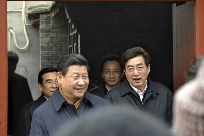 Chinese President Xi Jinping, centre left, is accompanied by Beijing's Party Secretary Guo Jinlong, right during an unannounced visit to a residential alley in Beijing, China in this Feb. 25, 2014 file photo.