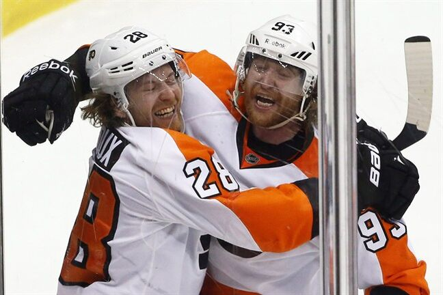 Philadelphia Flyers' Claude Giroux (28) celebrates his goal with teammate Jakub Voracek (93) in the third period of an NHL hockey game against the Pittsburgh Penguins in Pittsburgh, Saturday, April 12, 2014. The Philadelphia Flyers say they are aware of stories out of Ottawa