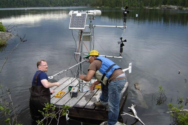 Scientists set-up a raft with one of a series of micro-meterological stations on a lake, in this undated photo. Scientific projects could die on the vine because of cuts to the federal Fisheries Department, university researchers say. THE CANADIAN PRESS