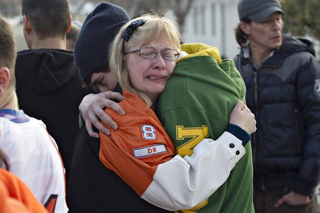 Holly Borden, mother of football player Walter Borden-Wilkins, is consoled outside the sentencing for Brenden Holubowich, who was given a three-year prison sentence in the deaths of four high school football players, in Grande Prairie Alberta, on Wednesday February 27, 2013. In October 2011, Brenden Holubowich's pick-up truck collided with a car carrying five members of the Warriors football team from Grande Prairie Composite High School, killing four of the teenagers and injuring one. THE CANADIAN PRESS/Jason Franson