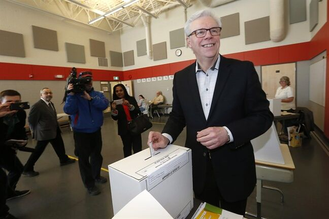 Manitoba NDP Leader and Premier Greg Selinger votes in the provincial election in Winnipeg, Tuesday, April 19, 2016. THE CANADIAN PRESS/John Woods