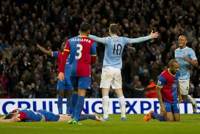 Manchester City's Edin Dzeko, centre right, celebrates after scoring against Crystal Palace during their English Premier League soccer match at the Etihad Stadium, Manchester, England, Saturday Dec. 28, 2013. (AP Photo/Jon Super)