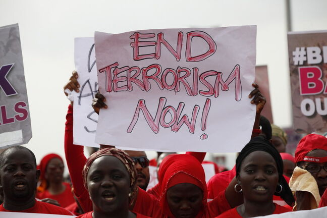 People attend a demonstration calling on the government to rescue the kidnapped girls of the government secondary school in Chibok, in Abuja, Nigeria, Thursday. Scores of protesters chanting