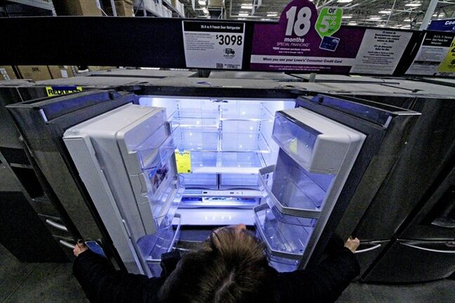 In this Thursday, Jan. 16, 2014, photo, a General Electric refrigerator is displayed at a Lowe's store in Cranberry Township, Pa. The Commerce Department releases durable goods report for December, on Tuesday, Jan. 28, 2014. (AP Photo/Gene J. Puskar)