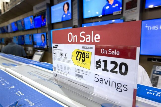FILE - In this Friday, Nov. 29, 2013, file photo TV sets, are on sale in the Pembroke Pines, Fla. Best Buy store. As stores clear out older merchandise and new models get introduced, good deals abound if you want a big new TV for the Super Bowl or video games. (AP Photo/J Pat Carter, File)